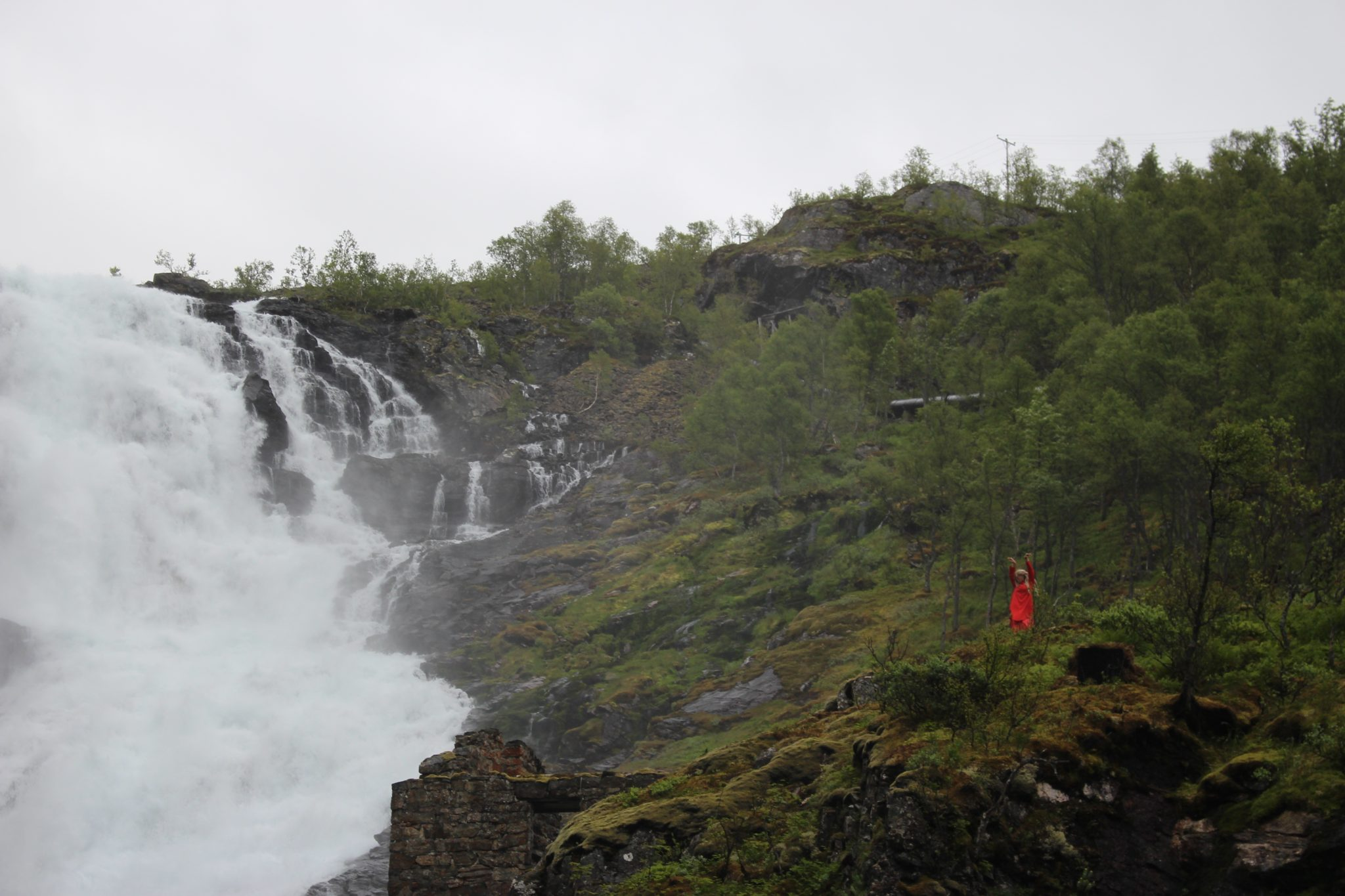 Kjosfossen waterfall dancing woman Norway in a Nutshell