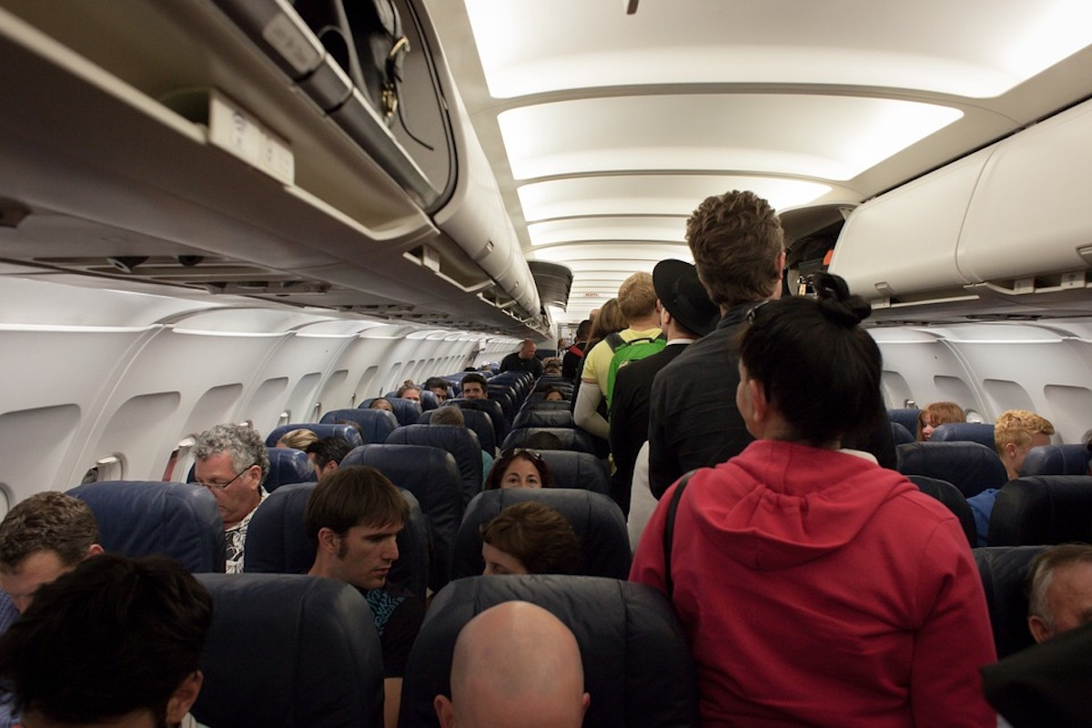 Woman Kicked Off Plane Over Vomit and Arrested