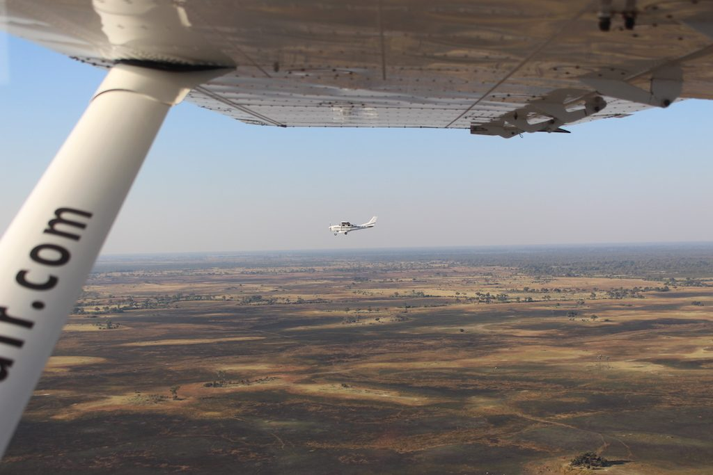 Flying over the Okavango Delta with our G Adventures Africa tour
