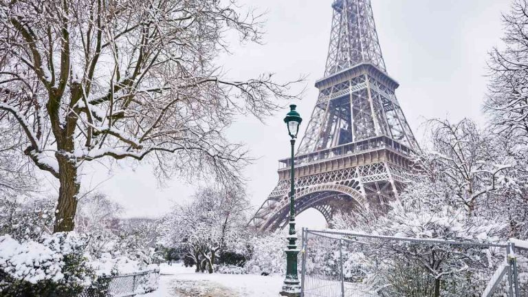winter city breaks in europe cover - snowy eiffel tower